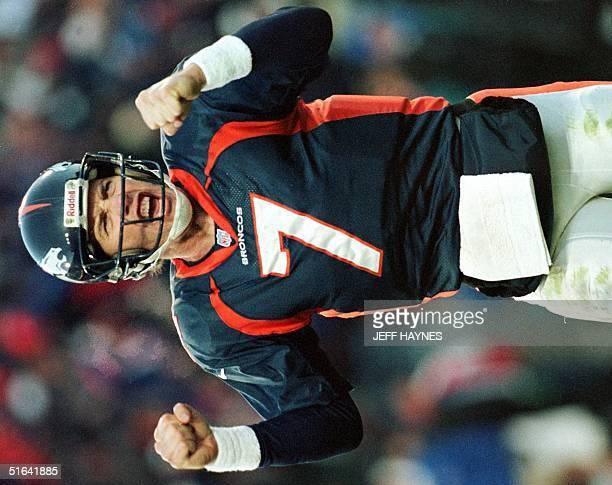 Denver Broncos quarterback John Elway celebrates after a second half touchdown 27 December in Denver's AFC Wild Card game with the Jacksonville...