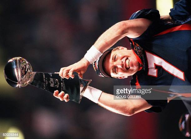 Denver Broncos quarterback John Elway holds the Vince Lombardi trophy after the Broncos defeated the Green Bay Packers 3124 to win Super Bowl XXXII...