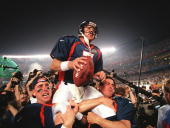 Denver Broncos quarterback John Elway is carried by teammates Ed McCaffrey and Bubby Brister after the Broncos defeated the Green Bay Packers 3124 to...