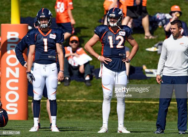Denver Broncos quarterback Kyle Sloter and quarterback Paxton Lynch look on during practice on August 14 2017 in Denver Colorado at Dove Valley