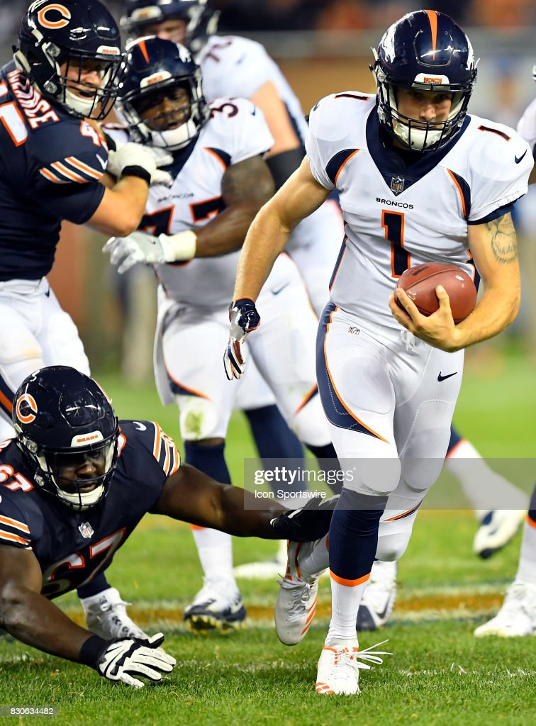Denver Broncos quarterback Kyle Sloter (1) runs with the football during the preseason game between the Denver Broncos and the Chicago Bears on August 10, 2017 at Soldier Field in Chicago, Illinois.