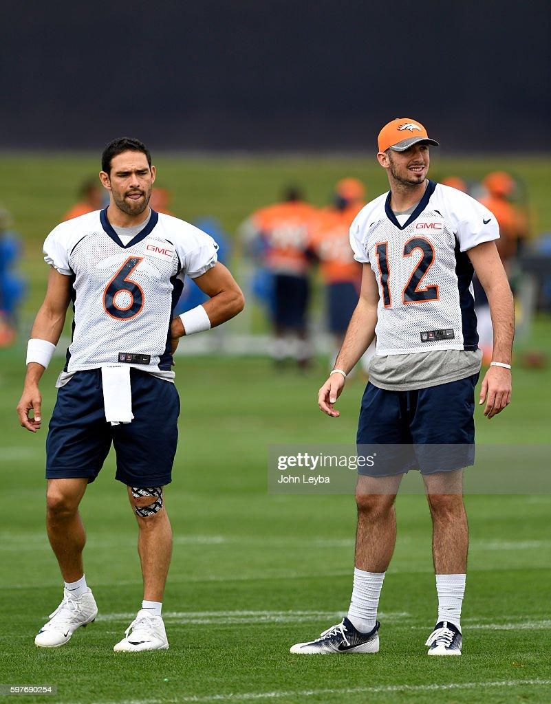 Denver Broncos quarterback Mark Sanchez and Denver Broncos quarterback Paxton Lynch watch drills during practice August 29 2016 at Dove Valley