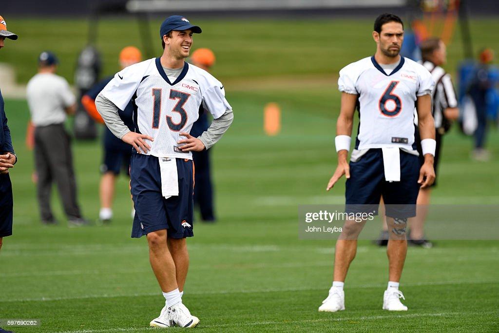 Denver Broncos quarterback Mark Sanchez and Denver Broncos quarterback Trevor Siemian watch drills during practice August 29 2016 at Dove Valley