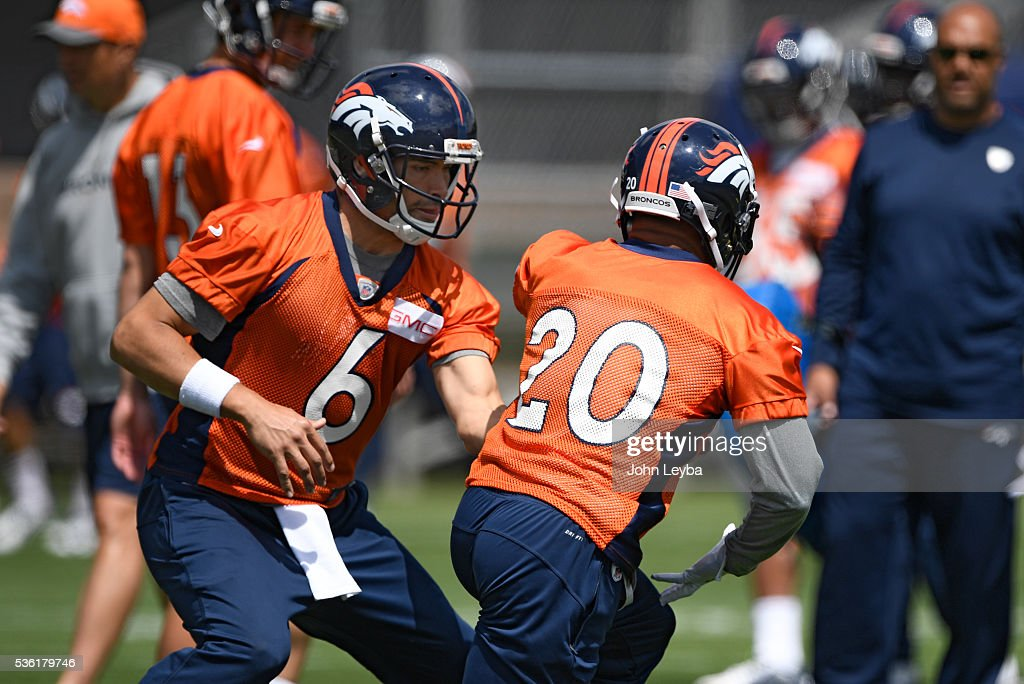 Denver Broncos quarterback <a gi-track='captionPersonalityLinkClicked' href=/galleries/search?phrase=Mark+Sanchez&family=editorial&specificpeople=690406 ng-click='$event.stopPropagation()'>Mark Sanchez</a> (6) hands off to <a gi-track='captionPersonalityLinkClicked' href=/galleries/search?phrase=Devontae+Booker&family=editorial&specificpeople=13592764 ng-click='$event.stopPropagation()'>Devontae Booker</a> (20) during OTA's May 31, 2016 at UCHealth Training Facility, Dove Valley.