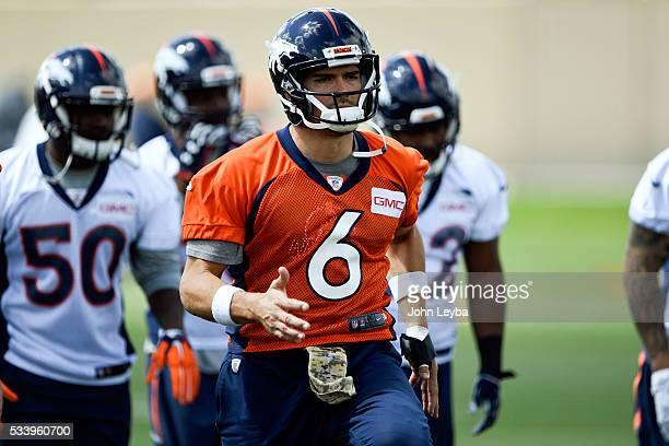 Denver Broncos quarterback Mark Sanchez loosens up during OTA's May 24 2016 at UCHealth Training Facility