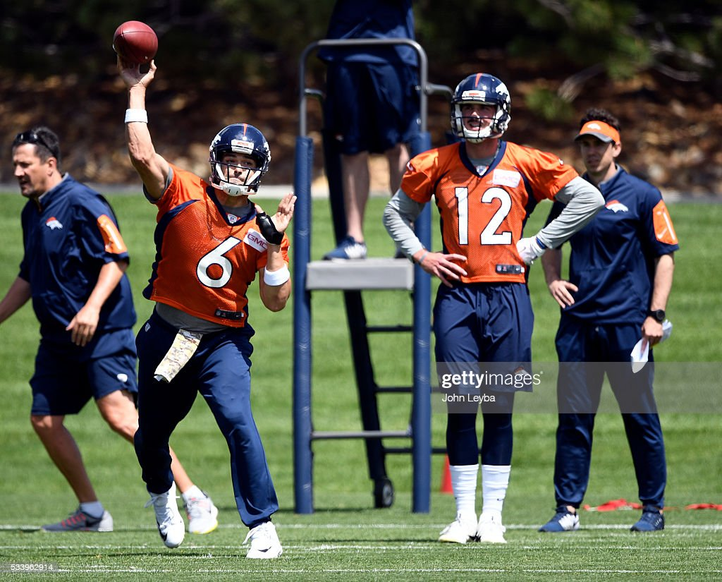 Denver Broncos quarterback <a gi-track='captionPersonalityLinkClicked' href=/galleries/search?phrase=Mark+Sanchez&family=editorial&specificpeople=690406 ng-click='$event.stopPropagation()'>Mark Sanchez</a> (6) throws a pass as <a gi-track='captionPersonalityLinkClicked' href=/galleries/search?phrase=Paxton+Lynch&family=editorial&specificpeople=11353849 ng-click='$event.stopPropagation()'>Paxton Lynch</a> (12) looks on during OTA's May 24, 2016 at UCHealth Training Facility.
