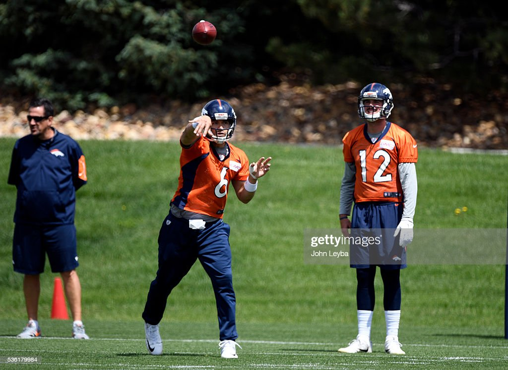 Denver Broncos quarterback <a gi-track='captionPersonalityLinkClicked' href=/galleries/search?phrase=Mark+Sanchez&family=editorial&specificpeople=690406 ng-click='$event.stopPropagation()'>Mark Sanchez</a> (6) throws a pass as quarterback <a gi-track='captionPersonalityLinkClicked' href=/galleries/search?phrase=Paxton+Lynch&family=editorial&specificpeople=11353849 ng-click='$event.stopPropagation()'>Paxton Lynch</a> (12) looks on during OTA's May 31, 2016 at UCHealth Training Facility, Dove Valley.