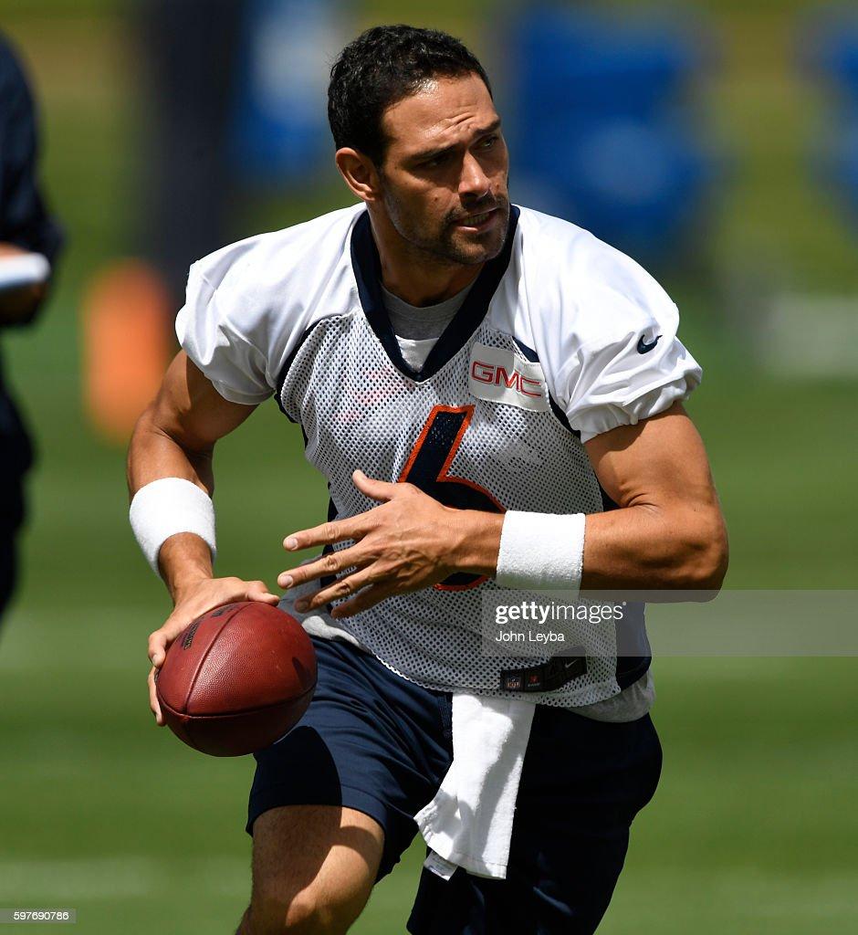 Denver Broncos quarterback Mark Sanchez turns to make a handoff during practice August 29 2016 at Dove Valley