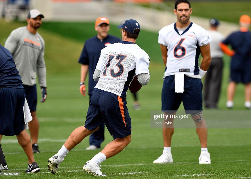 Denver Broncos quarterback Mark Sanchez watches Denver Broncos quarterback Trevor Siemian run through drills during practice August 29 2016 at Dove...