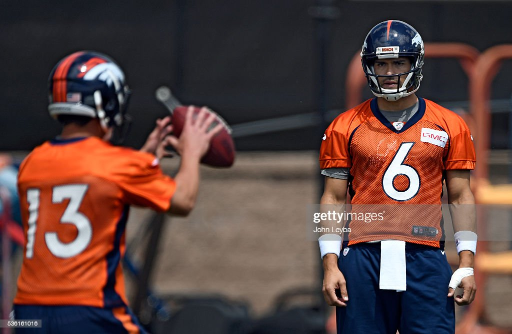 Denver Broncos quarterback <a gi-track='captionPersonalityLinkClicked' href=/galleries/search?phrase=Mark+Sanchez&family=editorial&specificpeople=690406 ng-click='$event.stopPropagation()'>Mark Sanchez</a> (6) watches<a gi-track='captionPersonalityLinkClicked' href=/galleries/search?phrase=Trevor+Siemian&family=editorial&specificpeople=8607385 ng-click='$event.stopPropagation()'>Trevor Siemian</a> (13) take the snap during OTA's May 31, 2016 at UCHealth Training Facility, Dove Valley.