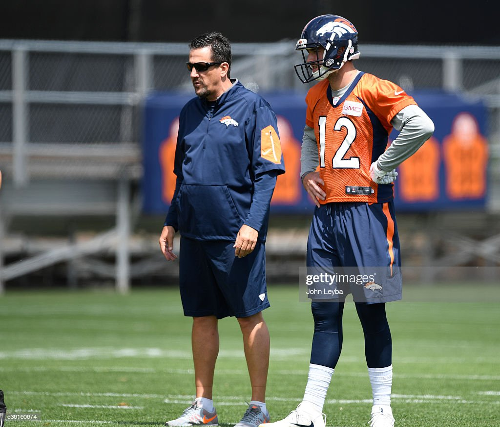 Denver Broncos quarterback <a gi-track='captionPersonalityLinkClicked' href=/galleries/search?phrase=Paxton+Lynch&family=editorial&specificpeople=11353849 ng-click='$event.stopPropagation()'>Paxton Lynch</a> (12O stands with quarterbacks coach <a gi-track='captionPersonalityLinkClicked' href=/galleries/search?phrase=Greg+Knapp&family=editorial&specificpeople=750404 ng-click='$event.stopPropagation()'>Greg Knapp</a> during OTA's May 31, 2016 at UCHealth Training Facility, Dove Valley.