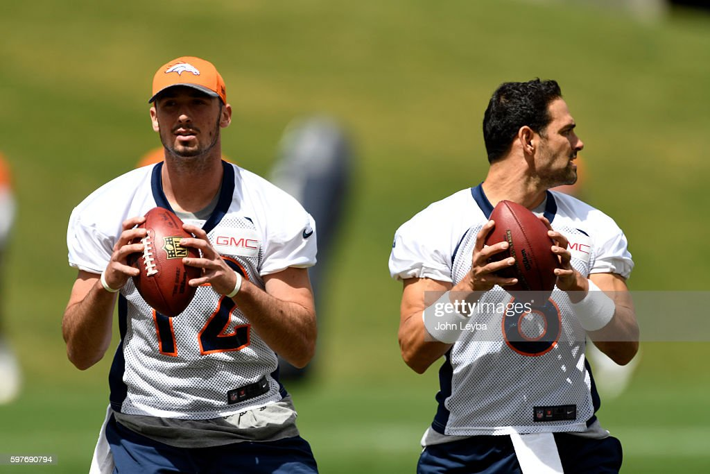 Denver Broncos quarterback Paxton Lynch and Denver Broncos quarterback Mark Sanchez run through drills during practice August 29 2016 at Dove Valley