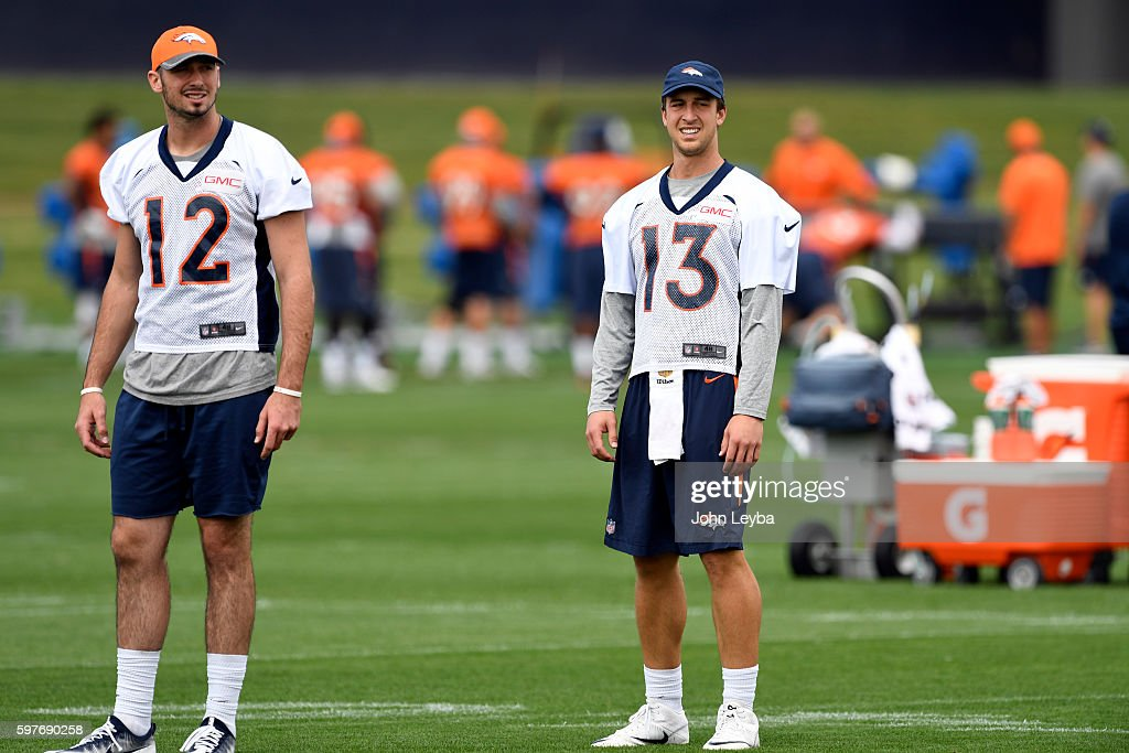 Denver Broncos quarterback Paxton Lynch and Denver Broncos quarterback Trevor Siemian watch drills during practice August 29 2016 at Dove Valley