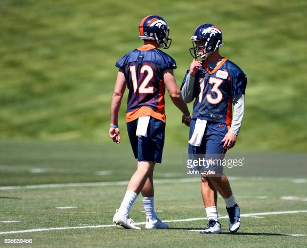 Denver Broncos quarterback Paxton Lynch and Denver Broncos quarterback Trevor Siemian take part in drills during mandatory mini camp on June 13 2017...