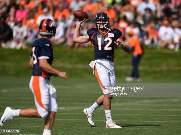 Denver Broncos quarterback Paxton Lynch during warmup drills with quarterback Trevor Siemian at Dove Valley August 03 2017