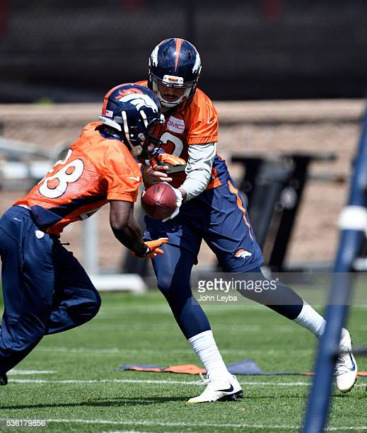 Denver Broncos quarterback Paxton Lynch hands off to Cyrus Gray during OTA's May 31 2016 at UCHealth Training Facility Dove Valley