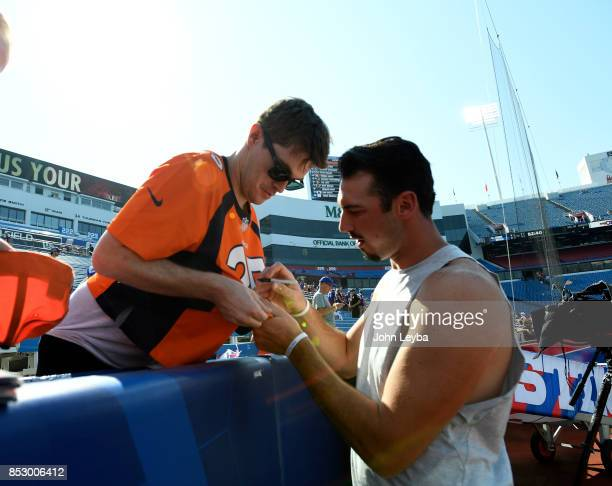 Denver Broncos quarterback Paxton Lynch signs autographs for fans as they take on the Buffalo Bills on September 24 2017 at New Era Field in Orchard...