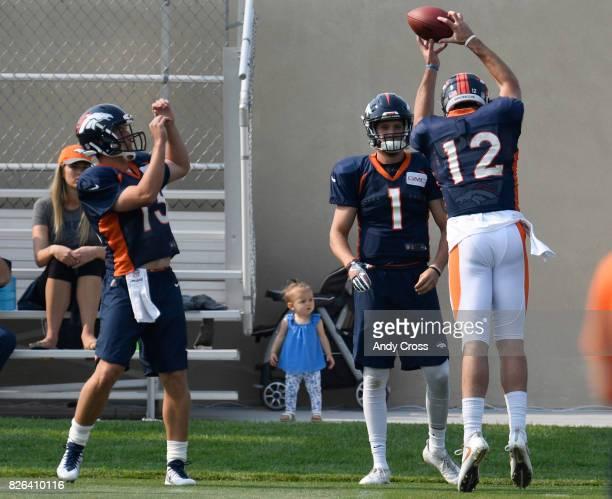 Denver Broncos quarterback Paxton Lynch snags an inbound tossback intended for Denver Broncos quarterback Trevor Siemian at Dove Valley August 04 2017