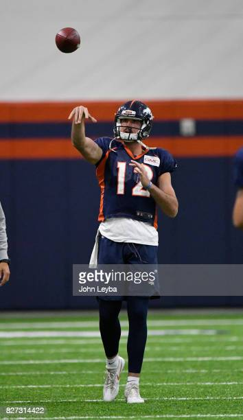Denver Broncos quarterback Paxton Lynch warms up during practice The team moved practice indoors during training training camp on August 7 2017 in...