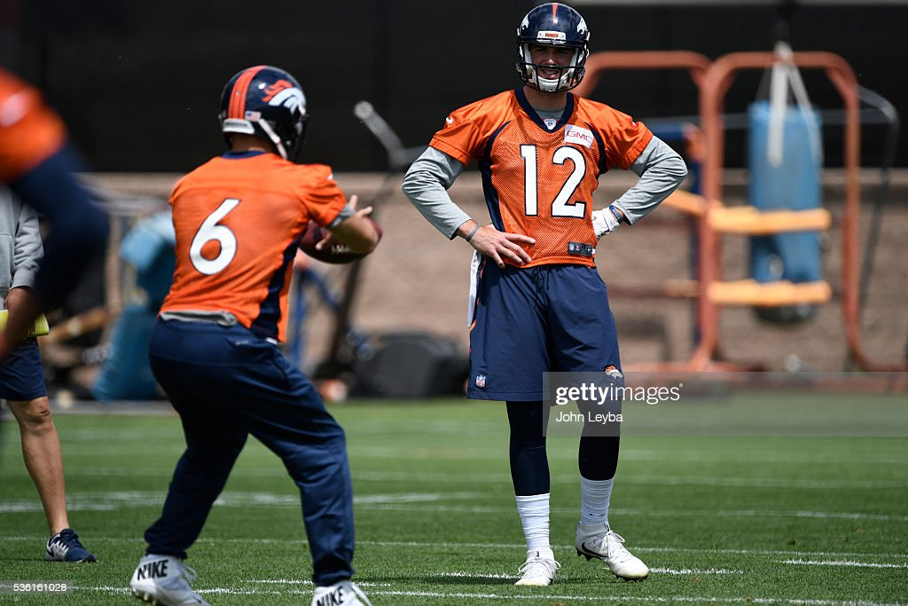 Denver Broncos quarterback <a gi-track='captionPersonalityLinkClicked' href=/galleries/search?phrase=Paxton+Lynch&family=editorial&specificpeople=11353849 ng-click='$event.stopPropagation()'>Paxton Lynch</a> (12) watches <a gi-track='captionPersonalityLinkClicked' href=/galleries/search?phrase=Mark+Sanchez&family=editorial&specificpeople=690406 ng-click='$event.stopPropagation()'>Mark Sanchez</a> (6) take the snap during OTA's May 31, 2016 at UCHealth Training Facility, Dove Valley.