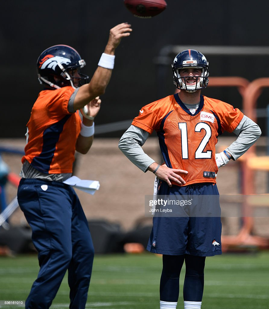 Denver Broncos quarterback <a gi-track='captionPersonalityLinkClicked' href=/galleries/search?phrase=Paxton+Lynch&family=editorial&specificpeople=11353849 ng-click='$event.stopPropagation()'>Paxton Lynch</a> (12) watches <a gi-track='captionPersonalityLinkClicked' href=/galleries/search?phrase=Mark+Sanchez&family=editorial&specificpeople=690406 ng-click='$event.stopPropagation()'>Mark Sanchez</a> (6) throw a pass during OTA's May 31, 2016 at UCHealth Training Facility, Dove Valley.
