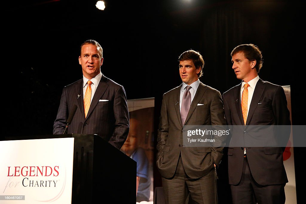 Denver Broncos quarterback Payton Manning, New York Giants quarterback Eli Manning, and Cooper Manning attend the 2013 Legends For Charity Dinner Honoring their father, Archie Manning at the Hyatt Regency New Orleans on January 31, 2013 in New Orleans, Louisiana.