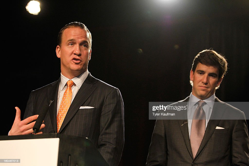 Denver Broncos quarterback Peyton Manning and New York Giants quarterback Eli Manning attend the 2013 Legends For Charity Dinner Honoring Archie Manning at the Hyatt Regency New Orleans on January 31, 2013 in New Orleans, Louisiana.