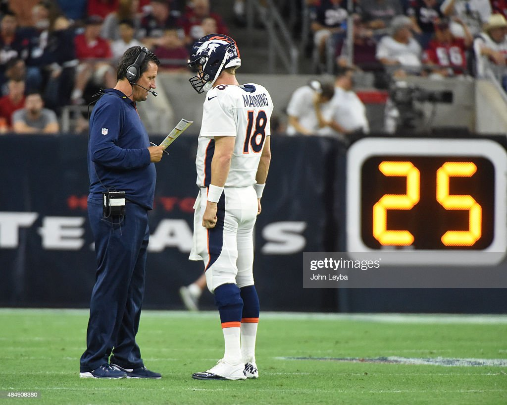 Denver Broncos quarterback <a gi-track='captionPersonalityLinkClicked' href=/galleries/search?phrase=Peyton+Manning&family=editorial&specificpeople=184524 ng-click='$event.stopPropagation()'>Peyton Manning</a> (18) checks in with quarterbacks coach <a gi-track='captionPersonalityLinkClicked' href=/galleries/search?phrase=Greg+Knapp&family=editorial&specificpeople=750404 ng-click='$event.stopPropagation()'>Greg Knapp</a> during the first quarter against the Houston Texans August 22, 2015 at NRG Stadium.