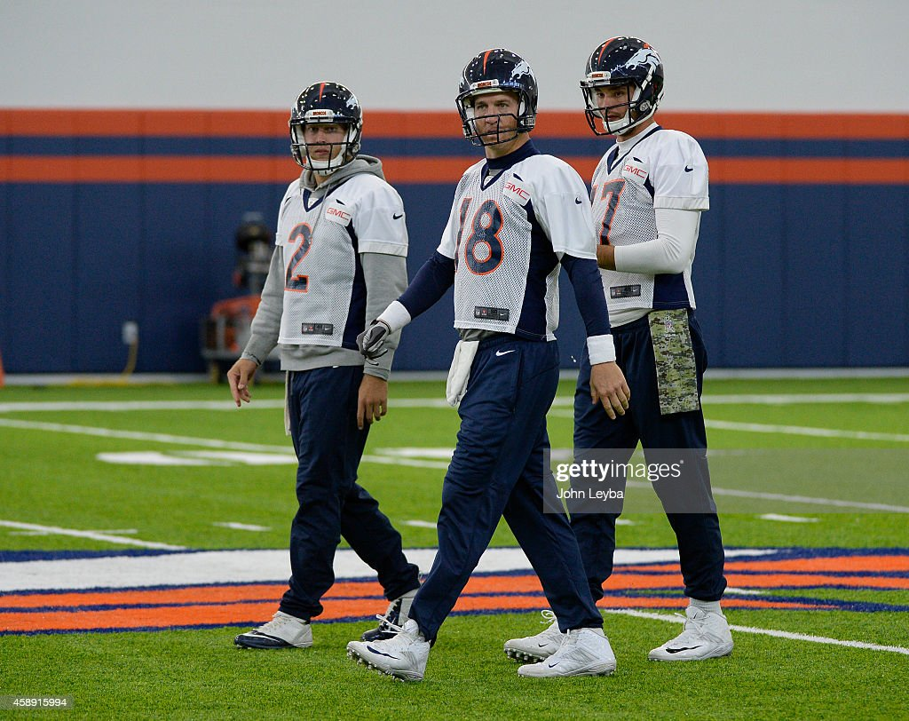 Denver Broncos quarterback <a gi-track='captionPersonalityLinkClicked' href=/galleries/search?phrase=Peyton+Manning&family=editorial&specificpeople=184524 ng-click='$event.stopPropagation()'>Peyton Manning</a> (18) Denver Broncos quarterback Zac Desert (2) and Denver Broncos quarterback <a gi-track='captionPersonalityLinkClicked' href=/galleries/search?phrase=Brock+Osweiler&family=editorial&specificpeople=6501030 ng-click='$event.stopPropagation()'>Brock Osweiler</a> (17) head to drills as the team takes practice indoors at the new field house at Dove Valley November 13, 2014 as temperatures reach 12 degrees.
