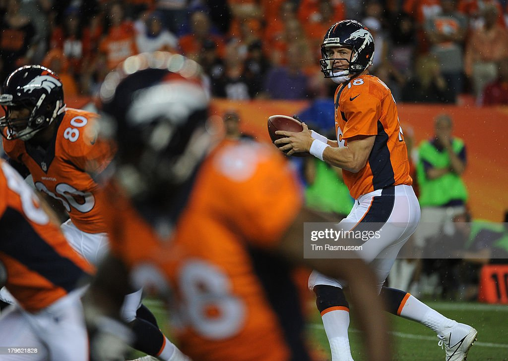 Denver Broncos quarterback Peyton Manning (18) drops back to pass in the first quarter. The Denver Broncos took on the Baltimore Ravens in the first game of the 2013 season at Sports Authority Field at Mile High in Denver on September 5, 2013.