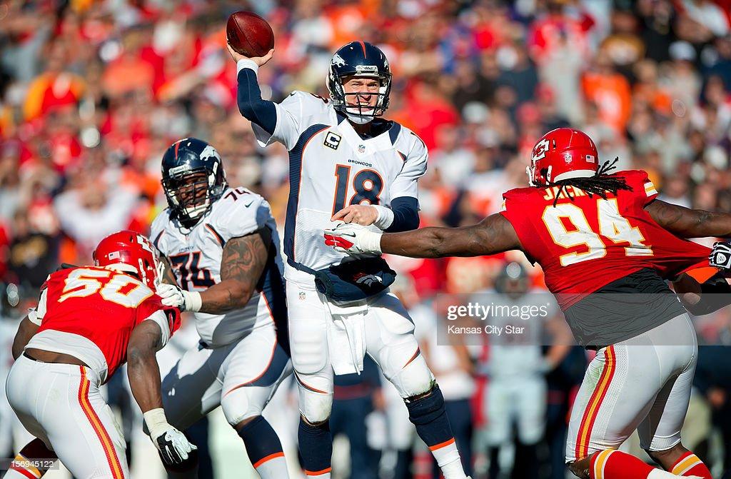 Denver Broncos quarterback Peyton Manning (18) eludes the rush of Kansas City Chiefs defensive end Tyson Jackson (94) to throw a 7-yard touchdown pass at Arrowhead Stadium on Sunday, November 25, 2012, in Kansas City, Missouri. The Denver Broncos defeated the Kansas City Chiefs, 17-9.