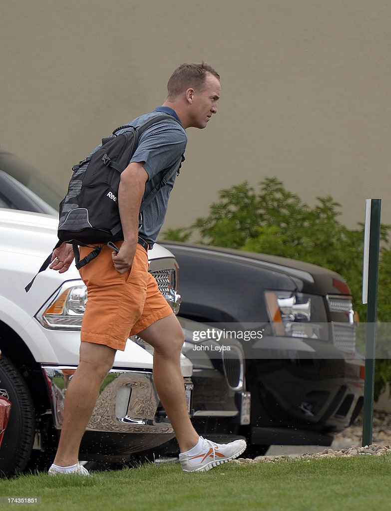 Denver Broncos quarterback Peyton Manning exits his car as he reports to camp July 24, 2013 at Dove Valley. The players had physicals at the teams headquarters.