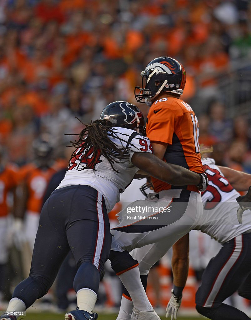 Denver Broncos quarterback Peyton Manning gets sacked by Houston Texans defensive tackle Ricardo Mathews during the first quarter August 23 2014 at...