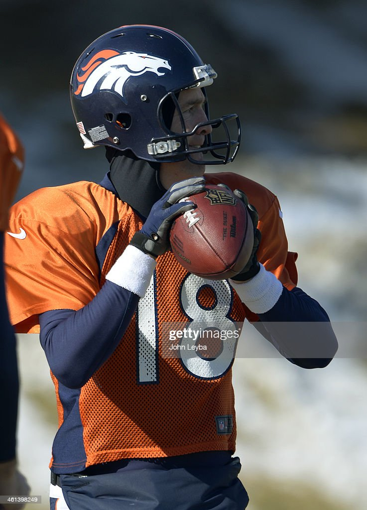 Denver Broncos quarterback Peyton Manning (18) looks to throw down field during practice January 8, 2014 at Dove Valley. The Denver Broncos are preparing for their Divisional Game against the San Diego Chargers at Sports Authority Field.