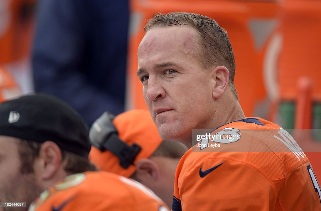 Denver Broncos quarterback Peyton Manning (18) looks up at the scoreboard from the bench against the Philadelphia Eagles September 29, 2013 at Sports Authority Field at Mile High.