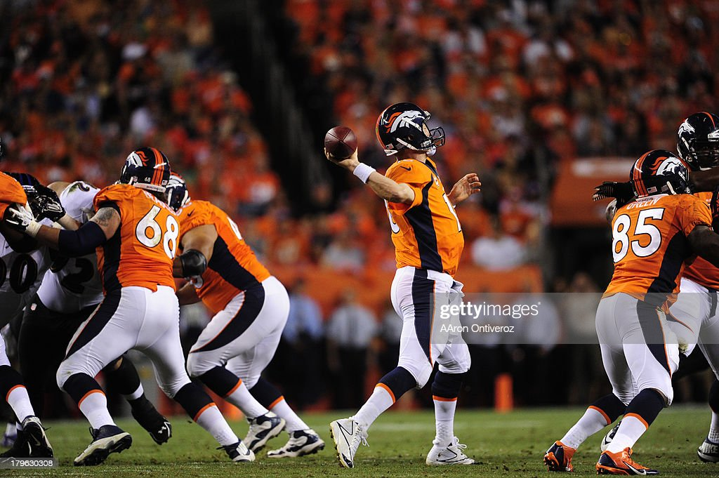 Denver Broncos quarterback Peyton Manning (18) makes a pass in the third quarter. The Denver Broncos took on the Baltimore Ravens in the first game of the 2013 season at Sports Authority Field at Mile High in Denver on September 5, 2013.