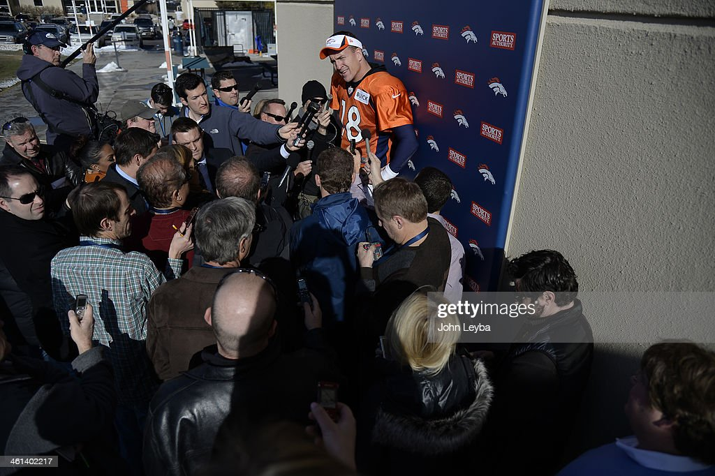 Denver Broncos quarterback Peyton Manning (18) meets with the media after practice January 8, 2014 at Dove Valley