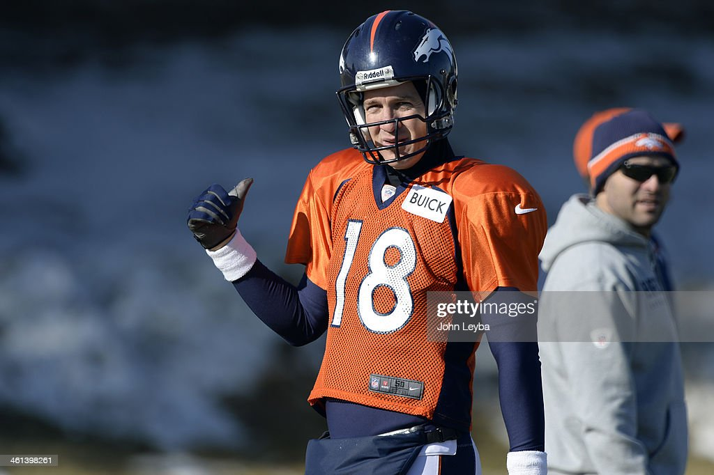 Denver Broncos quarterback Peyton Manning (18) runs through drills during practice January 8, 2014 at Dove Valley. The Denver Broncos are preparing for their Divisional Game against the San Diego Chargers at Sports Authority Field.