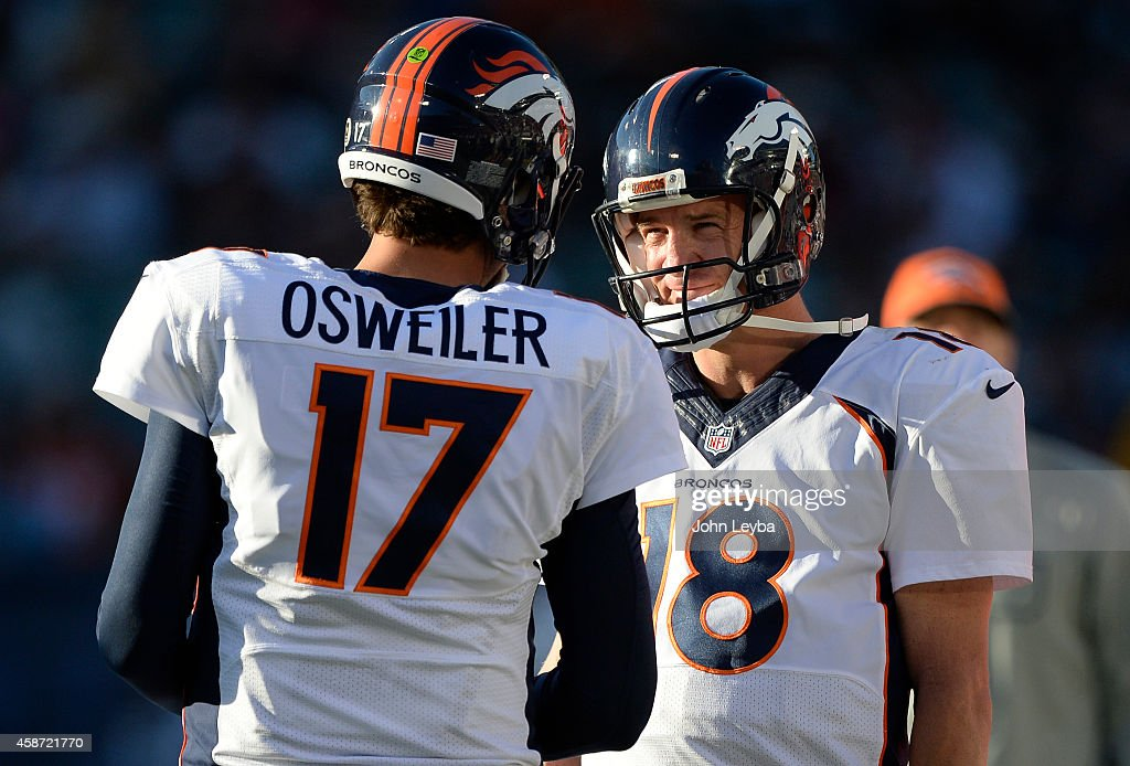 Denver Broncos quarterback <a gi-track='captionPersonalityLinkClicked' href=/galleries/search?phrase=Peyton+Manning&family=editorial&specificpeople=184524 ng-click='$event.stopPropagation()'>Peyton Manning</a> (18) smiles as he chats with Denver Broncos quarterback <a gi-track='captionPersonalityLinkClicked' href=/galleries/search?phrase=Brock+Osweiler&family=editorial&specificpeople=6501030 ng-click='$event.stopPropagation()'>Brock Osweiler</a> (17) late in the fourth quarter against the Oakland Raiders November 9, 2014 at O.co Coliseum.