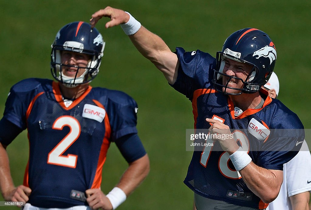 Denver Broncos quarterback <a gi-track='captionPersonalityLinkClicked' href=/galleries/search?phrase=Peyton+Manning&family=editorial&specificpeople=184524 ng-click='$event.stopPropagation()'>Peyton Manning</a> (18) throws a pass during drills on day five of the Denver Broncos 2014 training camp July 28, 2014 at Dove Valley.