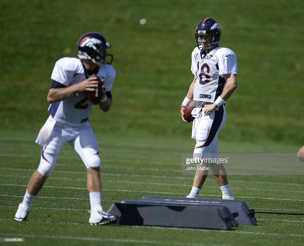 Denver Broncos quarterback <a gi-track='captionPersonalityLinkClicked' href=/galleries/search?phrase=Peyton+Manning&family=editorial&specificpeople=184524 ng-click='$event.stopPropagation()'>Peyton Manning</a> (18) watches quarterback <a gi-track='captionPersonalityLinkClicked' href=/galleries/search?phrase=Zac+Dysert&family=editorial&specificpeople=7172634 ng-click='$event.stopPropagation()'>Zac Dysert</a> (2) run through drills during practice September 17, 2014 at Dove Valley.