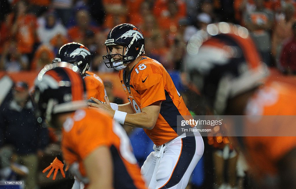 Denver Broncos quarterback Peyton Manning (18) yells from the line in the first quarter. The Denver Broncos took on the Baltimore Ravens in the first game of the 2013 season at Sports Authority Field at Mile High in Denver on September 5, 2013.