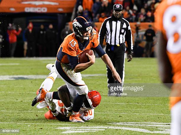 Denver Broncos quarterback Trevor Siemian gets tackled from behind by Kansas City Chiefs outside linebacker Justin Houston after a scramble out of...