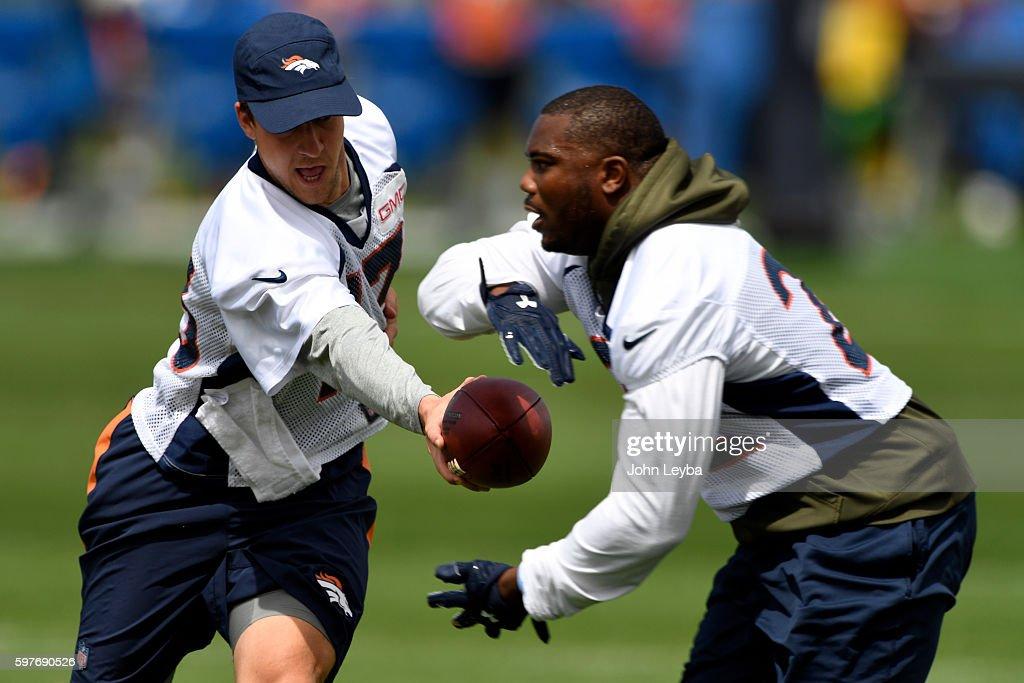 Denver Broncos quarterback Trevor Siemian hands off to Denver Broncos running back CJ Anderson during practice August 29 2016 at Dove Valley