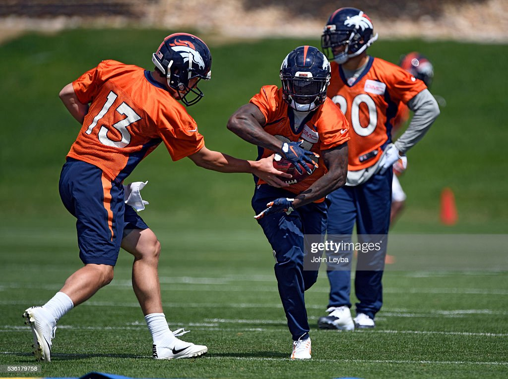 Denver Broncos quarterback <a gi-track='captionPersonalityLinkClicked' href=/galleries/search?phrase=Trevor+Siemian&family=editorial&specificpeople=8607385 ng-click='$event.stopPropagation()'>Trevor Siemian</a> (13) hands off to <a gi-track='captionPersonalityLinkClicked' href=/galleries/search?phrase=Ronnie+Hillman&family=editorial&specificpeople=7355403 ng-click='$event.stopPropagation()'>Ronnie Hillman</a> (23) during OTA's May 31, 2016 at UCHealth Training Facility, Dove Valley.