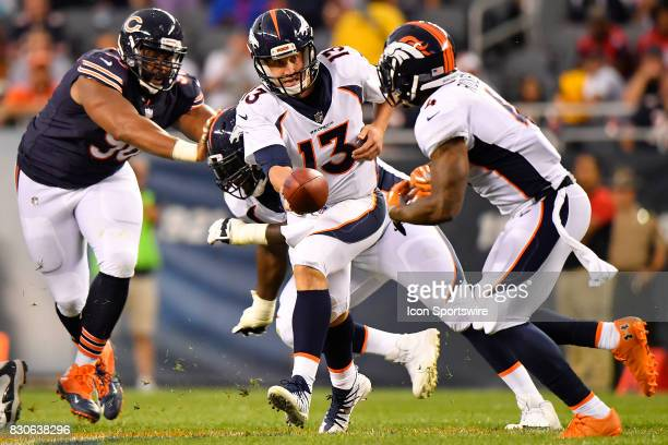 Denver Broncos quarterback Trevor Siemian hands the ball off to during the preseason game between the Denver Broncos and the Chicago Bears on August...