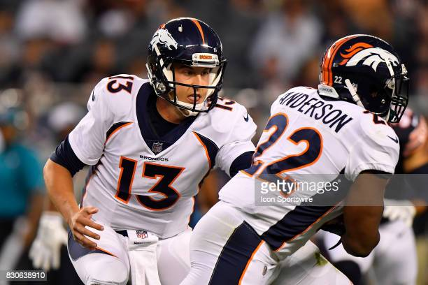 Denver Broncos quarterback Trevor Siemian hands the ball to Denver Broncos running back CJ Anderson during the preseason game between the Denver...