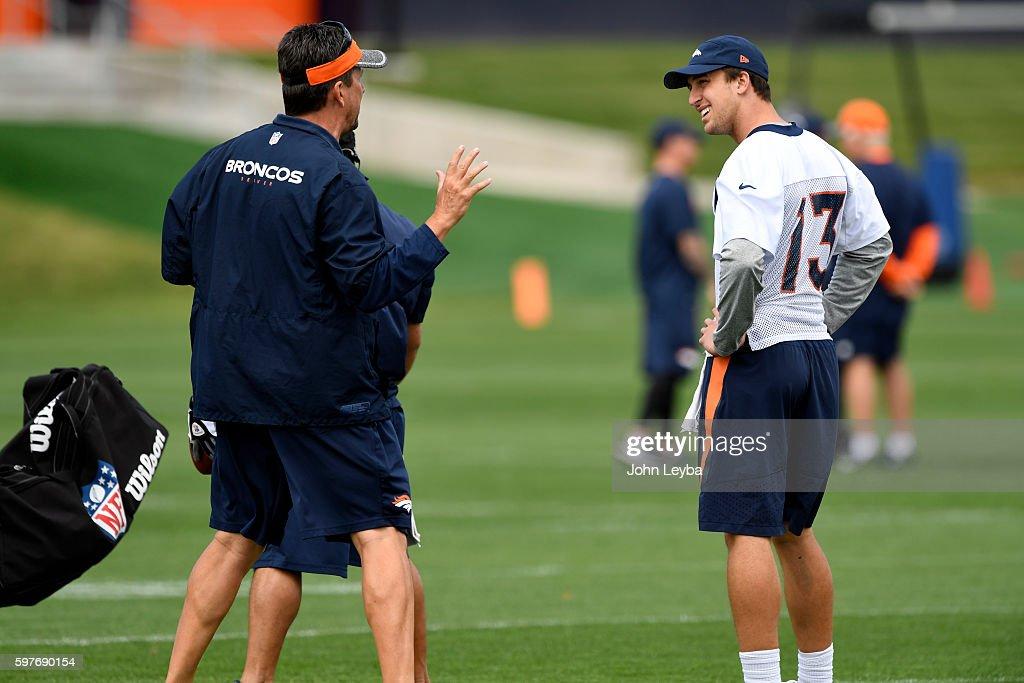 Denver Broncos quarterback Trevor Siemian looks over at quarterbacks coach Greg Knapp during practice August 29 2016 at Dove Valley