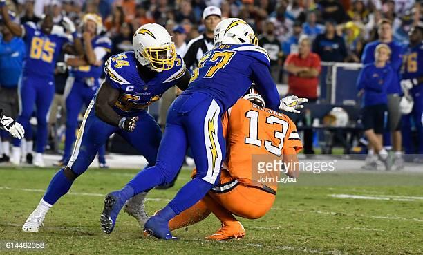 Denver Broncos quarterback Trevor Siemian prepares to get sacked by San Diego Chargers inside linebacker Jatavis Brown during the fourth quarter...