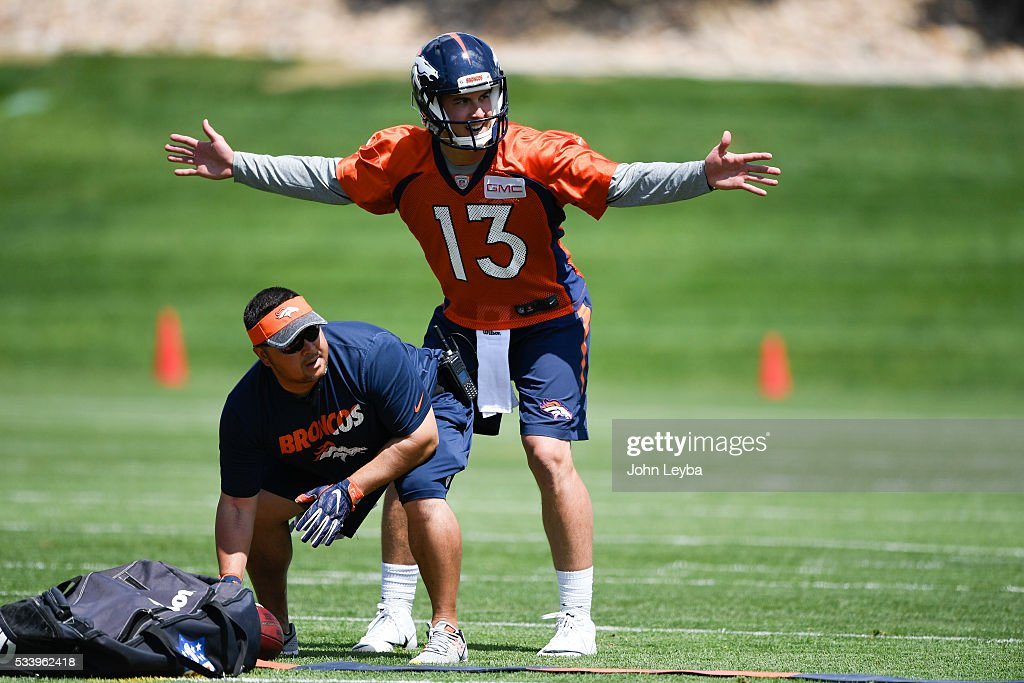 Denver Broncos quarterback Trevor Siemian (13) prepares to take the snap in drills during OTA's May 24, 2016 at UCHealth Training Facility.